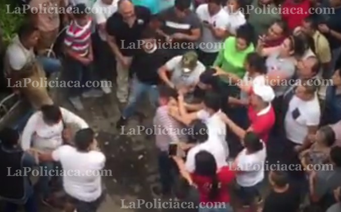 Thieves beat by the crowd